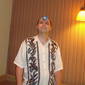 Doug sporting a shuffleboard puck.